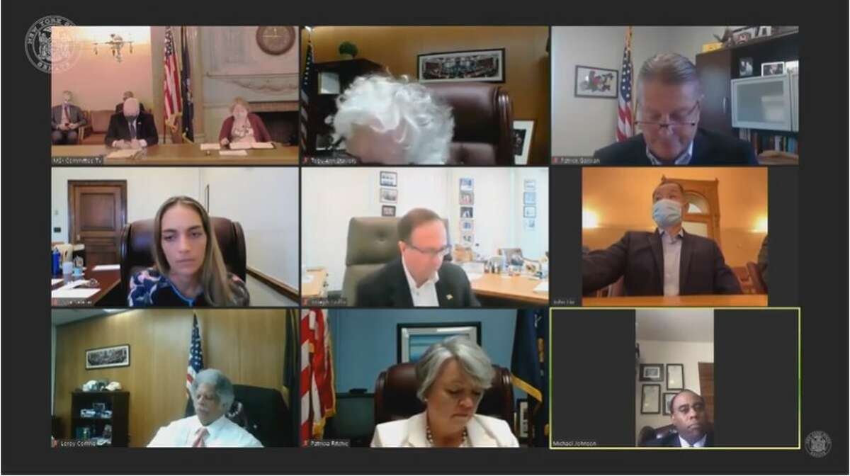 The New York Senate Finance Committee meets via Zoom on June 10, 2021. Michael Johnson (bottom right) gave a statement about his qualifications to become the Board of Elections' chief enforcement counsel.