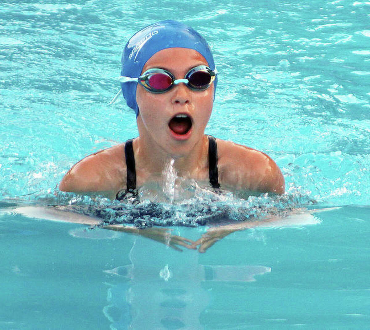 Montclaire's Morgan Poplar comes up for air during the breaststroke competition Thursday in the SWISA season opener at Summers Port in Godfrey.