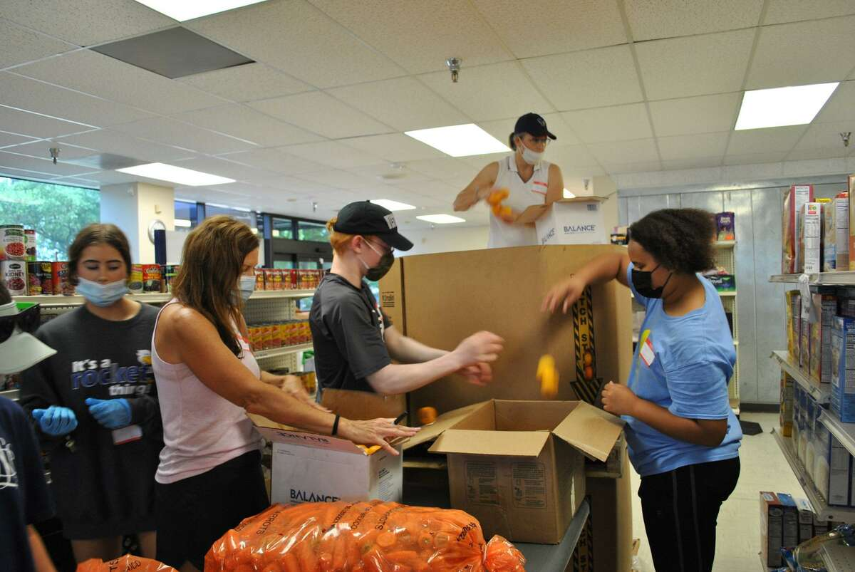 Klein UMC volunteered with Northwest Assistance Ministries, helping with food and more.