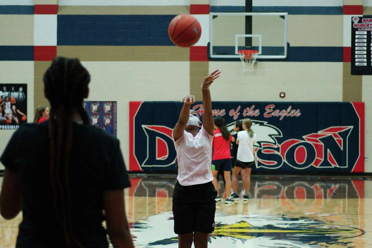 Taylor Brown participates in a shooting drill at the Dawson summer girls' basketball camp.