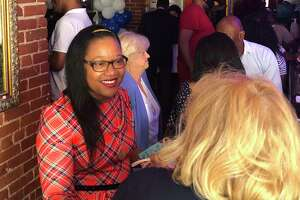 Immacula Cann, a Democrat running for mayor of Stratford, talks to a supporter during a fundraiser June 10, 2021 at Metric Bar and Grill.