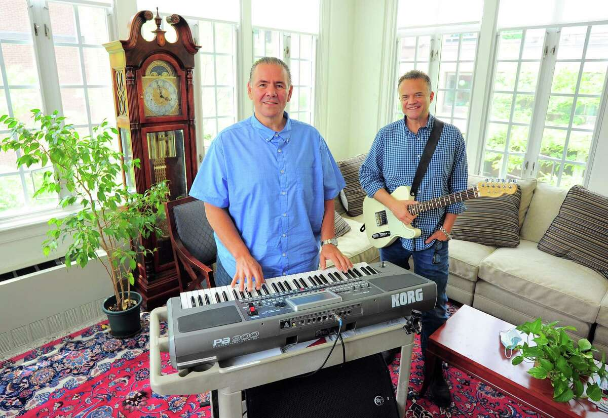 Musicians Michael Rinaldi, left, and Vincent Galizi pose together at Witherell Home in Greenwich, Conn., on Friday June 4, 2021. Both came to the Witherell to combine their love for music and performing with a rewarding career in therapeutic recreation.