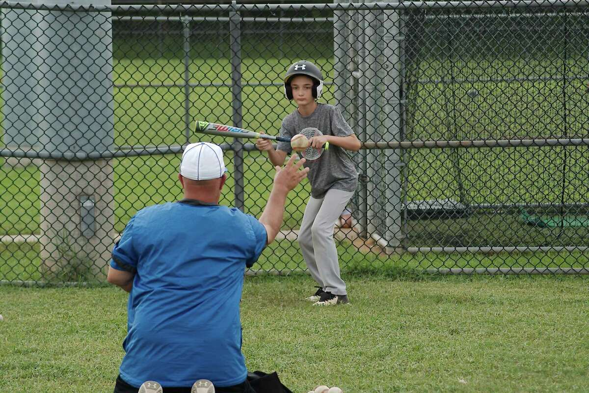 Cole Calagna sets up to bunt during a drill at the Clear Springs summer baseball camp.