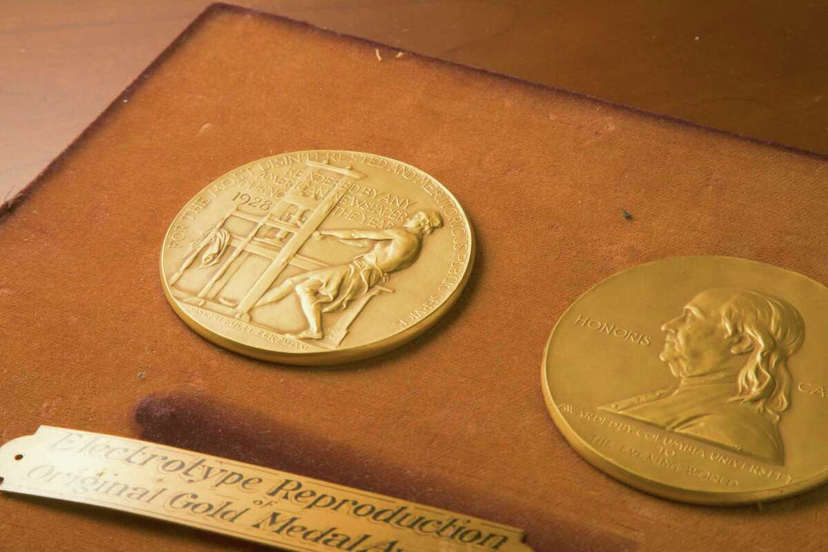This undated photo shows the front and back sides of the medal awarded for the Pulitzer Prizes in New York. The Pulitzer Prizes in journalism and the arts will be announced, Friday, June 11, 2021, almost two months later than initially planned due to the pandemic. (The Pulitzer Prizes via AP)