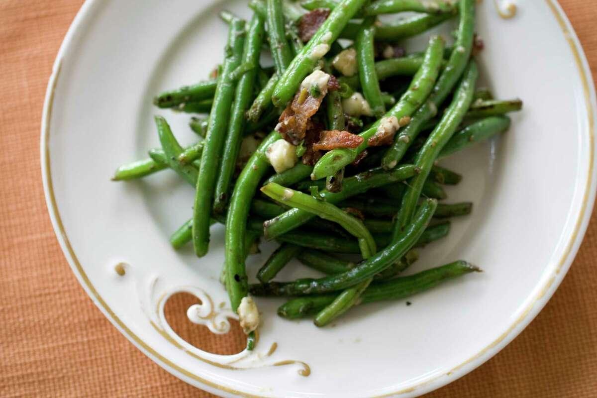 Lovina ate green beans atCarol and Aden's wedding.(AP Photo/Matthew Mead)