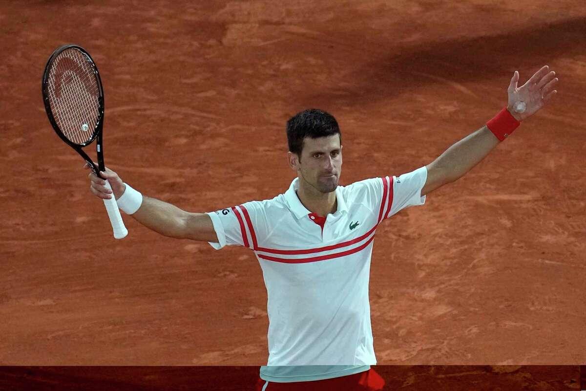 Serbia's Novak Djokovic celebrates as he defeats Spain's Rafael Nadal during their semifinal match of the French Open tennis tournament at the Roland Garros stadium Friday, June 11, 2021 in Paris. (AP Photo/Christophe Ena)