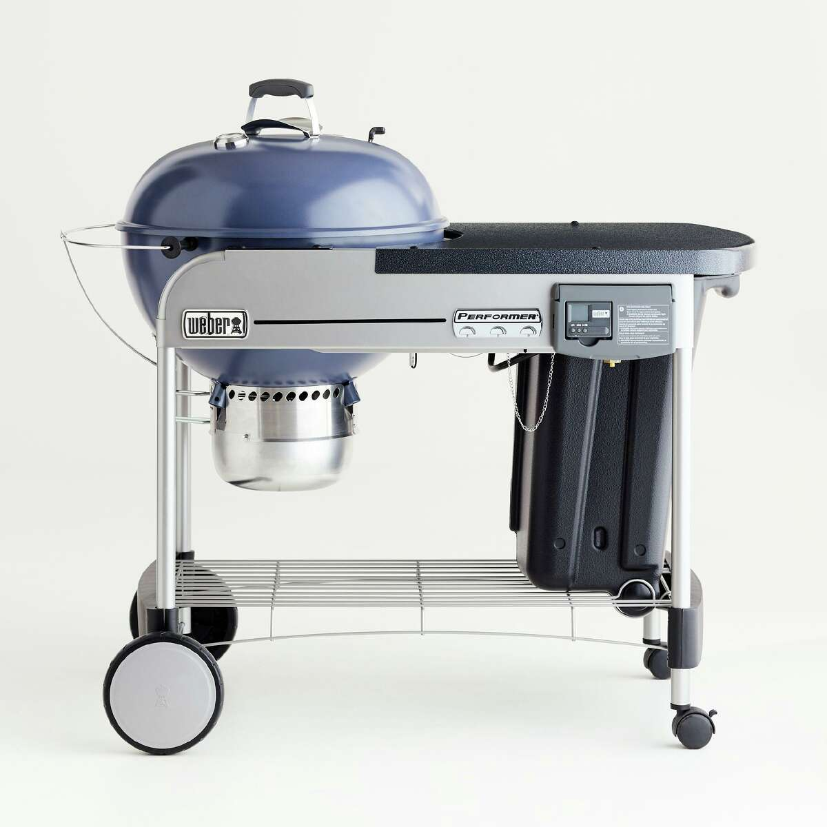 Weber Slate Blue Performer Deluxe Charcoal Grill, is the trusted grill-maker's elevated version of classic two-wheel kettle. It includes electronic gas ignition, cook timer and built-in thermometer, and one-touch cleaning system; $459 at Crate & Barrel stores and crateandbarrel.com.