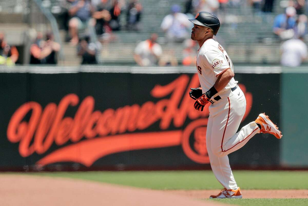 LaMonte Wade Jr. (31) rounds the bases after hitting his first inning solo homerun as the San Francsico Giants played the Chicago Cubs at Oracle Park in San Francisco, Calif., on Sunday, June 6, 2021.