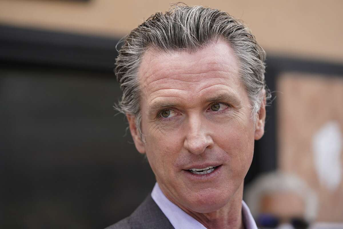 California Gov. Gavin Newsom listens to questions during a news conference in San Francisco, on June 3, 2021. It will cost California counties an estimated $215 million to stage an expected recall election this year that could oust Newsom from office. (AP Photo/Eric Risberg)