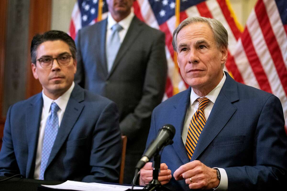 AUSTIN, TX - JUNE 08: State Rep. Chris Paddie listens as Texas Governor Greg Abbott speaks at a press conference where Abbott signed Senate Bills 2 and 3 at the Capitol on June 8, 2021 in Austin, Texas.