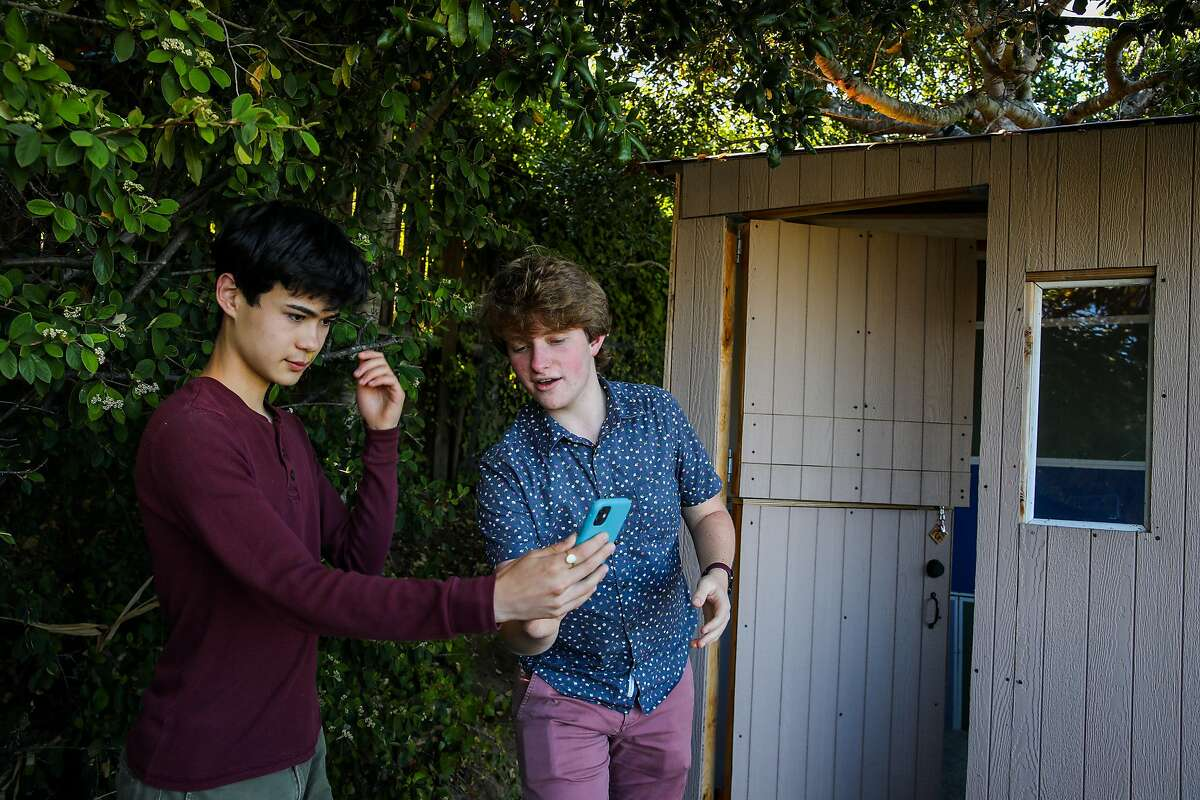 """Friends Samson Stebbins (left), 16, and Steven Sutton, 15, create a TikTok video in San Mateo. According to online publication GayTimes, the popular social video app has """"transformed into a place of education and self-discovery helping to reclaim the queer experience online."""""""