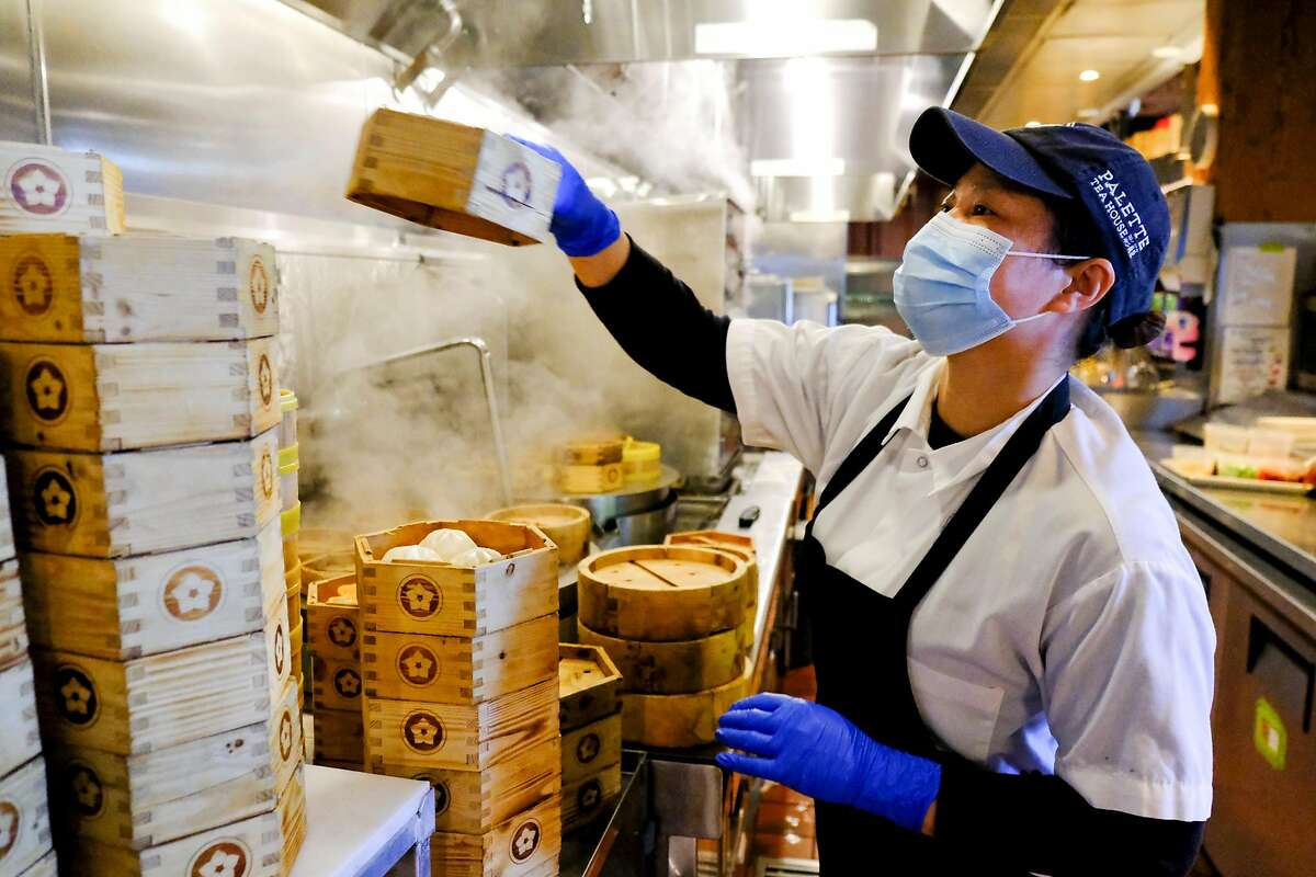 Line cook Lihua Guo operates the steamer at Palette Tea House in San Francisco.