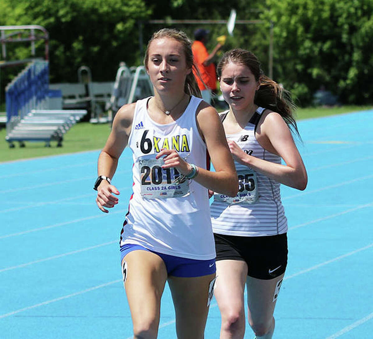 Roxana's Janelynn Wirth (left) leads Oak Park Fenwick's Katie Cahill during their 3,200-meters heat Friday at the Class 2A state meet in Charleston. Cahill won the heat and finished 11th overall, with Wirth second in the heat and 13th overall.
