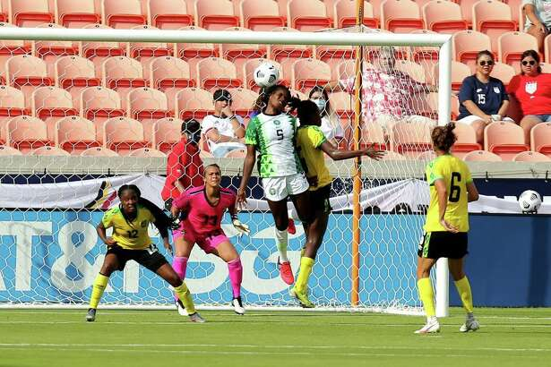 Nigeria's Ijeoma Okoronkwo (5) heads the ball upwards during the second half against Jamaica during a WNT Summer Series international friendly soccer match at BBVA Stadium in Houston.
