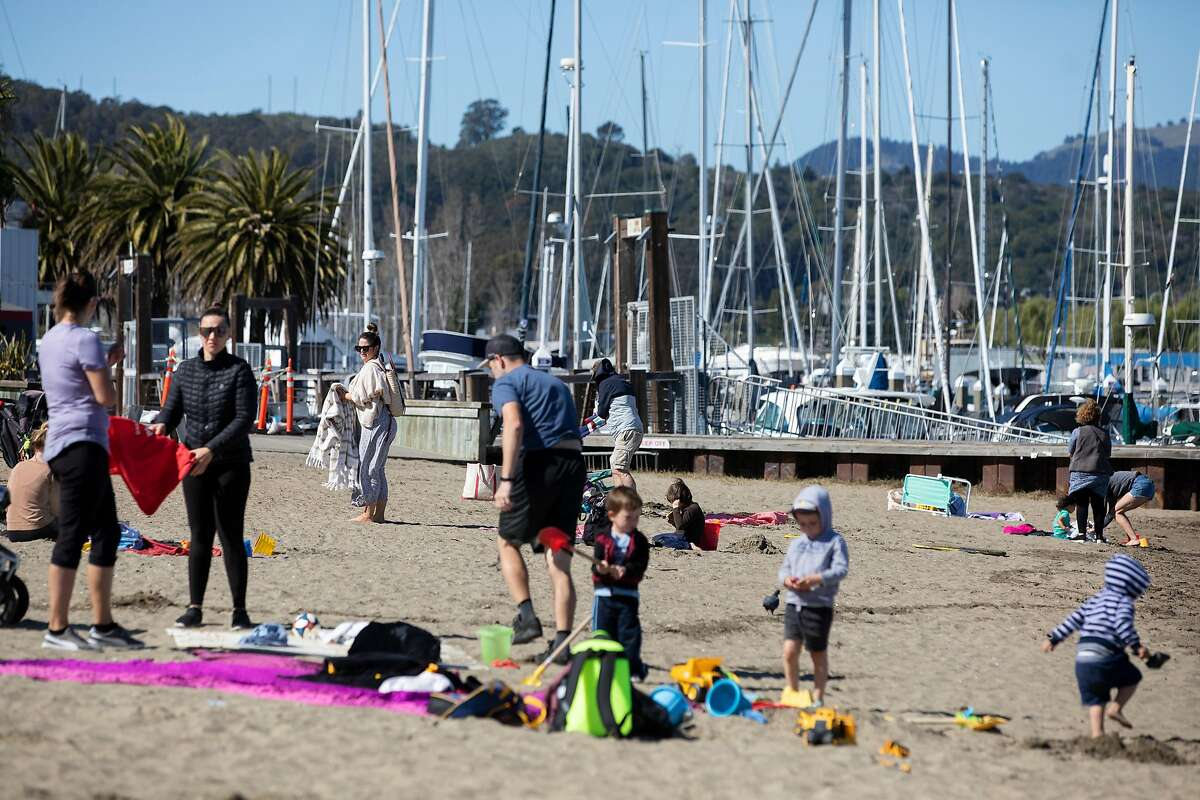 Families gather under the sun at Sausalito Beach in Sausalito , Calif. Tuesday, February 23, 2021. Temperatures in the North Bay are expected to reach into the 70s this week.
