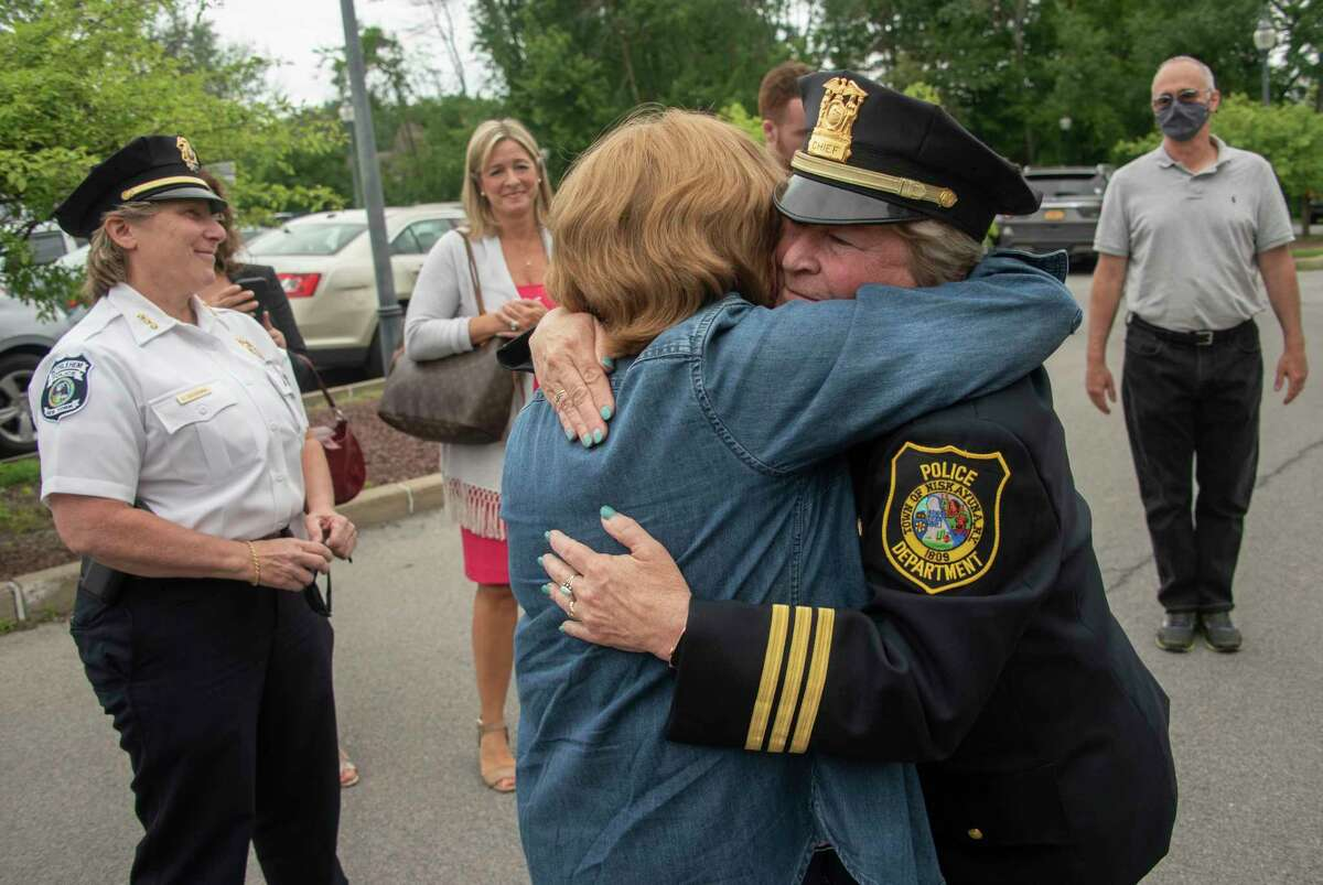 Outgoing Police Chief Frances Wall, right, gets a hug from Margaret Brennan as the Niskayuna Police Department honored her with a walk out ceremony outside the police department on Friday, June 11, 2021 in Niskayuna, N.Y. (Lori Van Buren/Times Union)