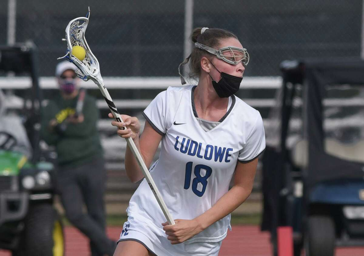 Ludlowe's Kaleigh Sommers (18) looks upfield during the Falcons' girls lacrosse game against Guilford at Taft Field in Fairfield on Tuesday, April 27. 2021.