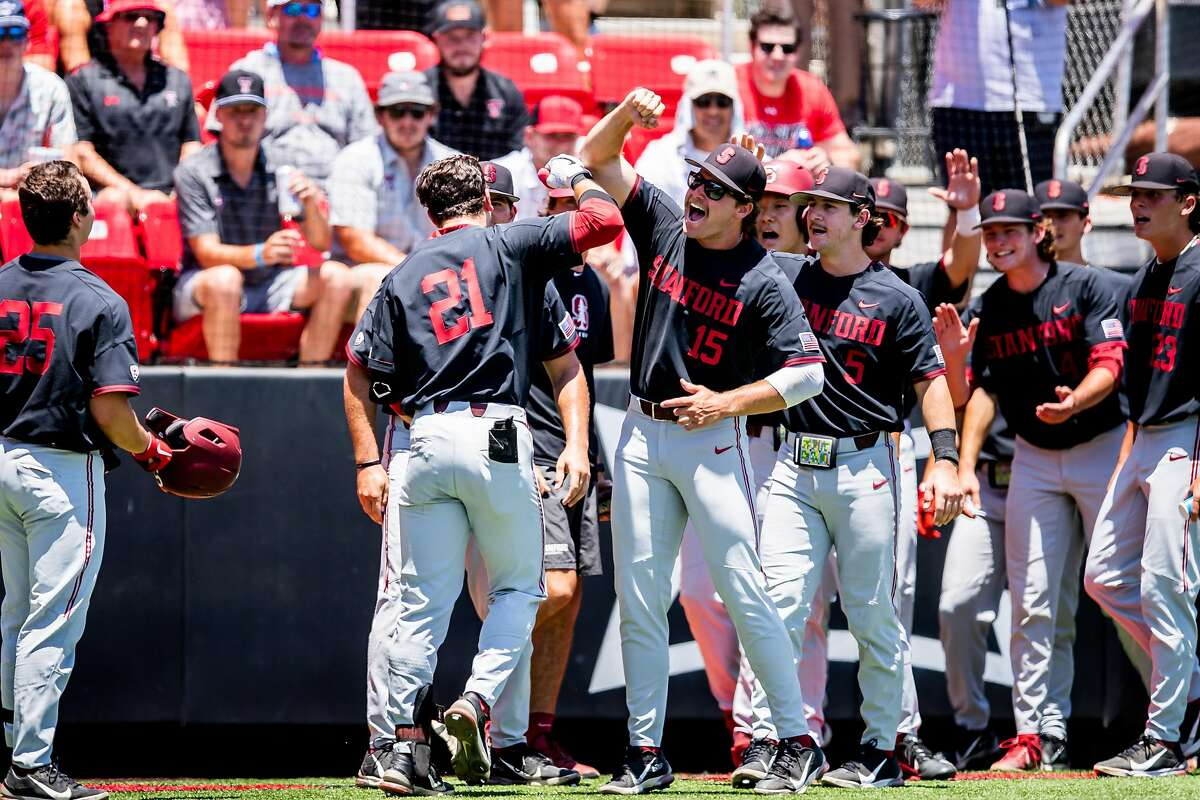 Stanford's Tim Tawa (21) is greeted by teammates after hitting a first-inning home run against Texas Tech in Lubbock, Texas.