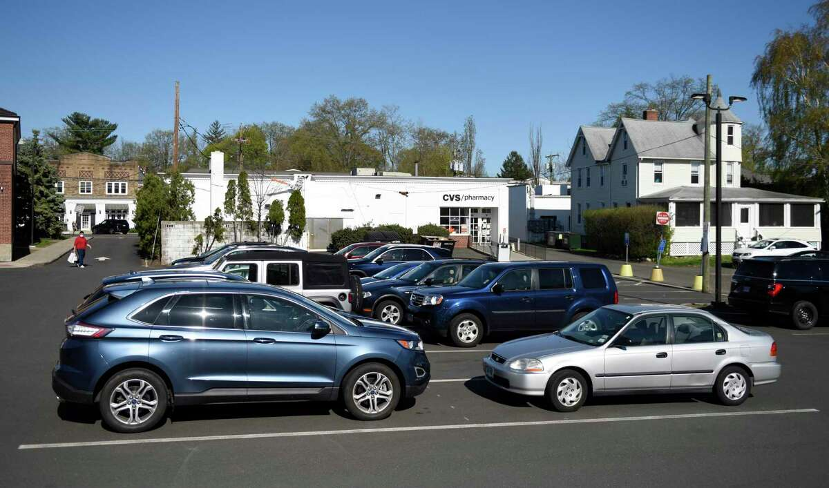 The CVS parking lot is nearly full during the middle of the day in Old Greenwich, Conn. Monday, April 26, 2021. Residents and merchants in the neighborhood shared their concerns about parking earlier this year with the Board of Selectmen.