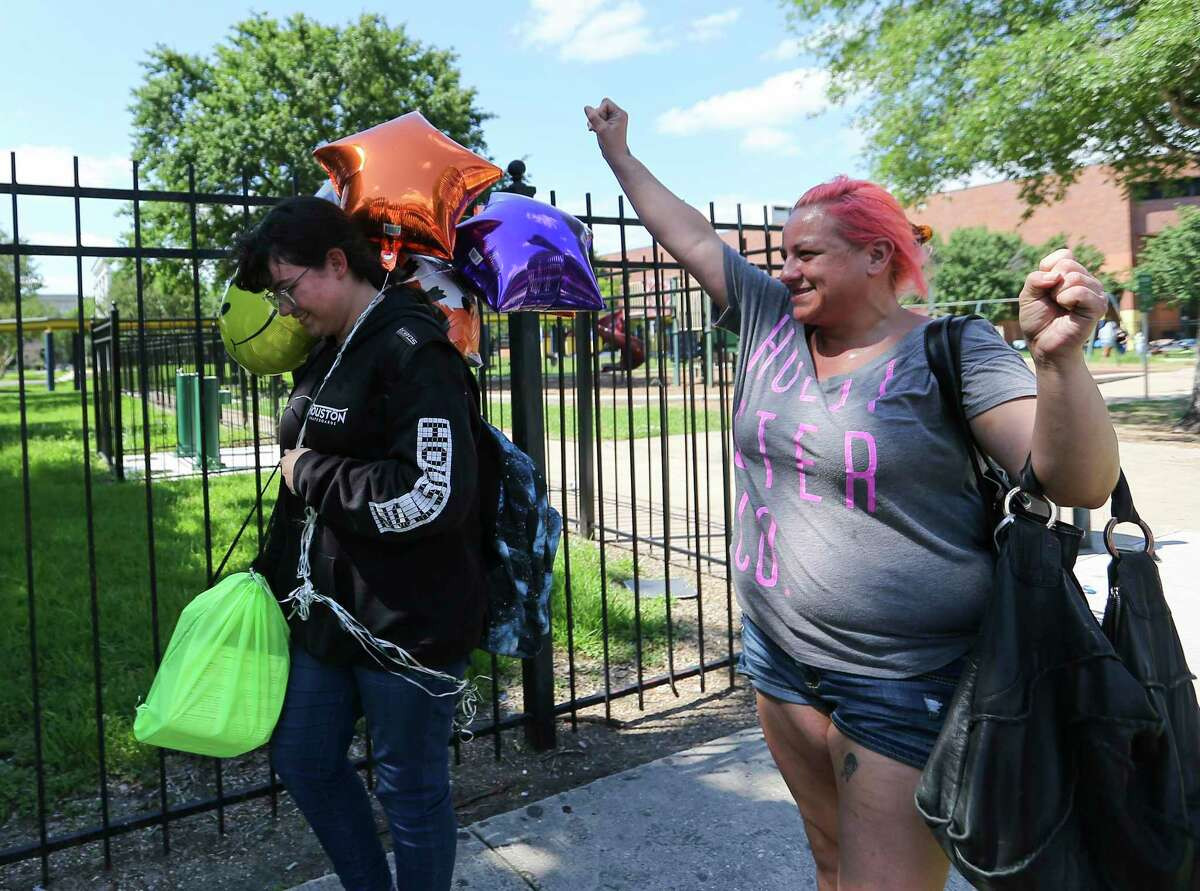 Chloe Torres, right, greets her sixth-grade daughter Catalina Harris with balloons on the last day of classes Friday at Houston ISD's Marshall Middle School. HISD and several other Houston-area districts were the last to close out the 2020-21 school year, which was prolonged by the pandemic.