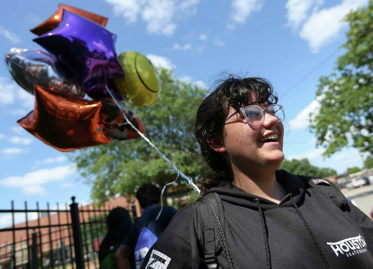 Marshall Middle School sixth-grader Catalina Harris carries her balloon-festooned backpack on the last day of classes Friday at the Houston ISD campus.