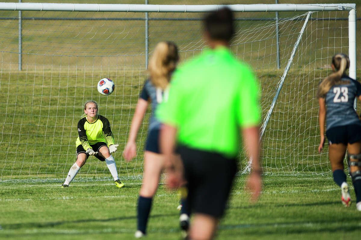 Calvary Baptist goalkeeper Emma Schmidtmakes a save during the Kings' regional championship loss to North Muskegon Friday, June 11, 2021 in Cadillac. (Katy Kildee/kkildee@mdn.net)