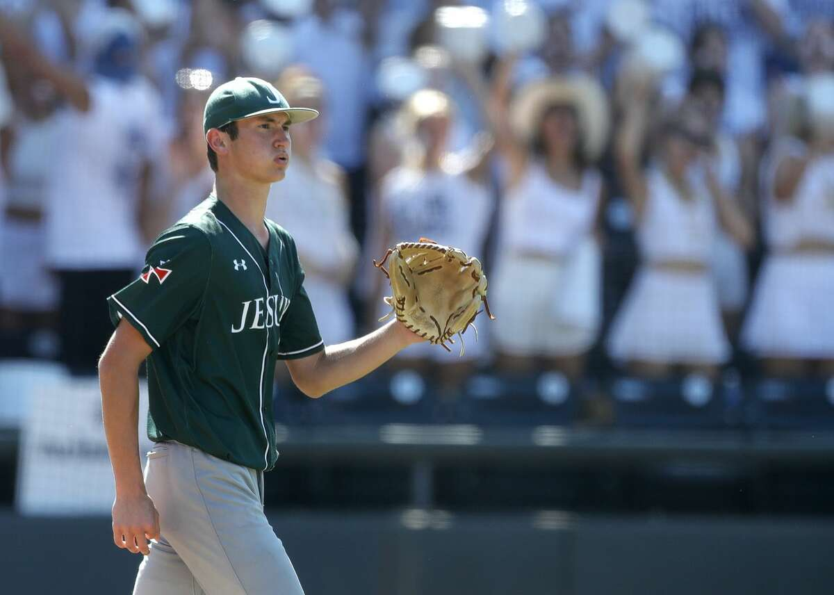 Strake Jesuit starting pitcher Garrett Stratton (16) reacts after giving up a run in the third inning of a Class 6A state semifinal game during the UIL State Baseball Championships at Dell Diamond, Friday, June 11, 2021, in Round Rock.