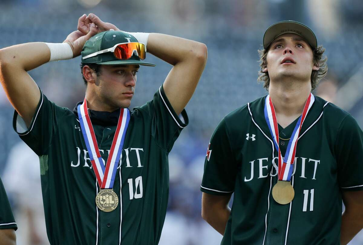 Strake Jesuit's Andy Leon, left, and Connor Bartlett reacts after losing to Keller 7-1 in a Class 6A state semifinal game during the UIL State Baseball Championships at Dell Diamond, Friday, June 11, 2021, in Round Rock.