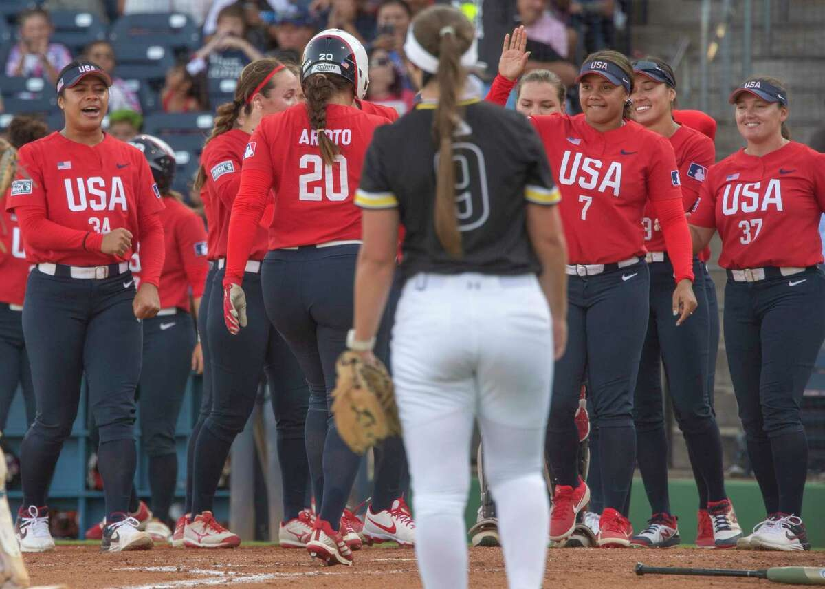Team USA's Valerie Arioto touches home on a two-run game winning homerun in the bottom of the seventh of the first game 06/11/2021 against Team Alliance at Momentum Bank Ballpark for a 7-5 victory. Tim Fischer/Reporter-Telegram