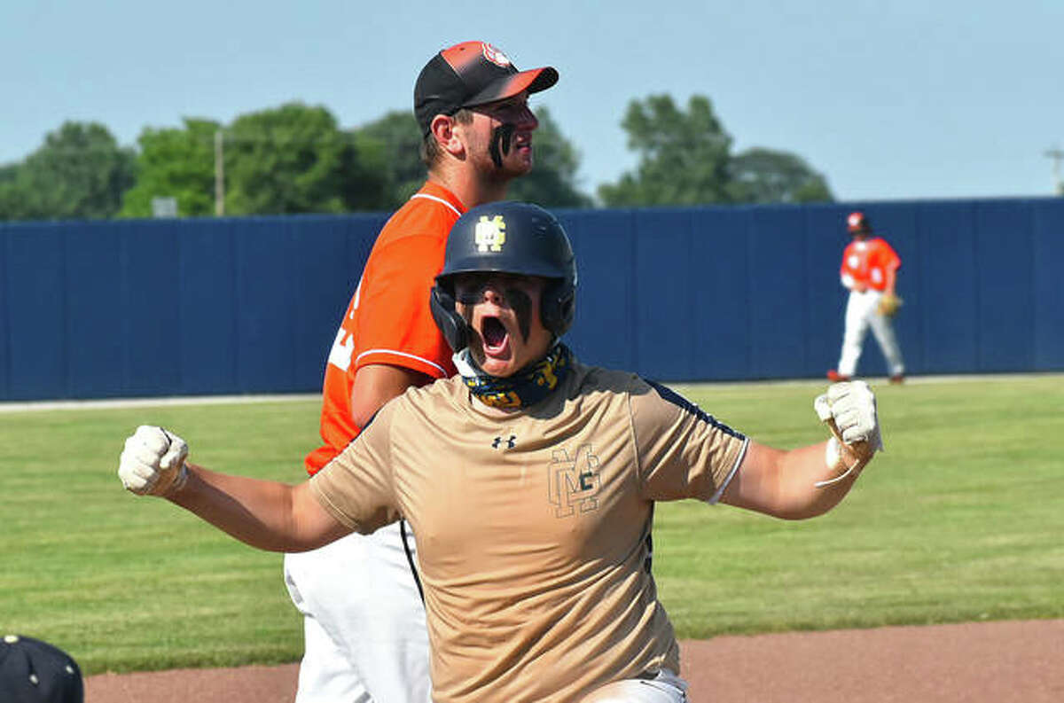 Father McGivney's Gabe Smith celebrates after hitting a two-run triple in the first inning against Greenfield in a Class 1A sectional championship game.