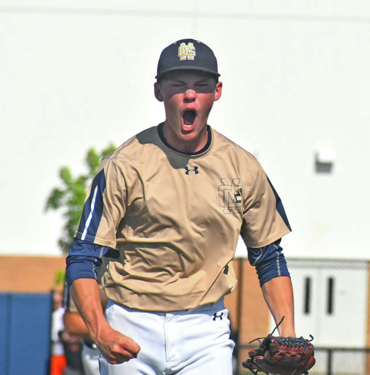 Father McGivney starting pitcher Jackson Rodgers reacts after striking out three straight to end the first inning.