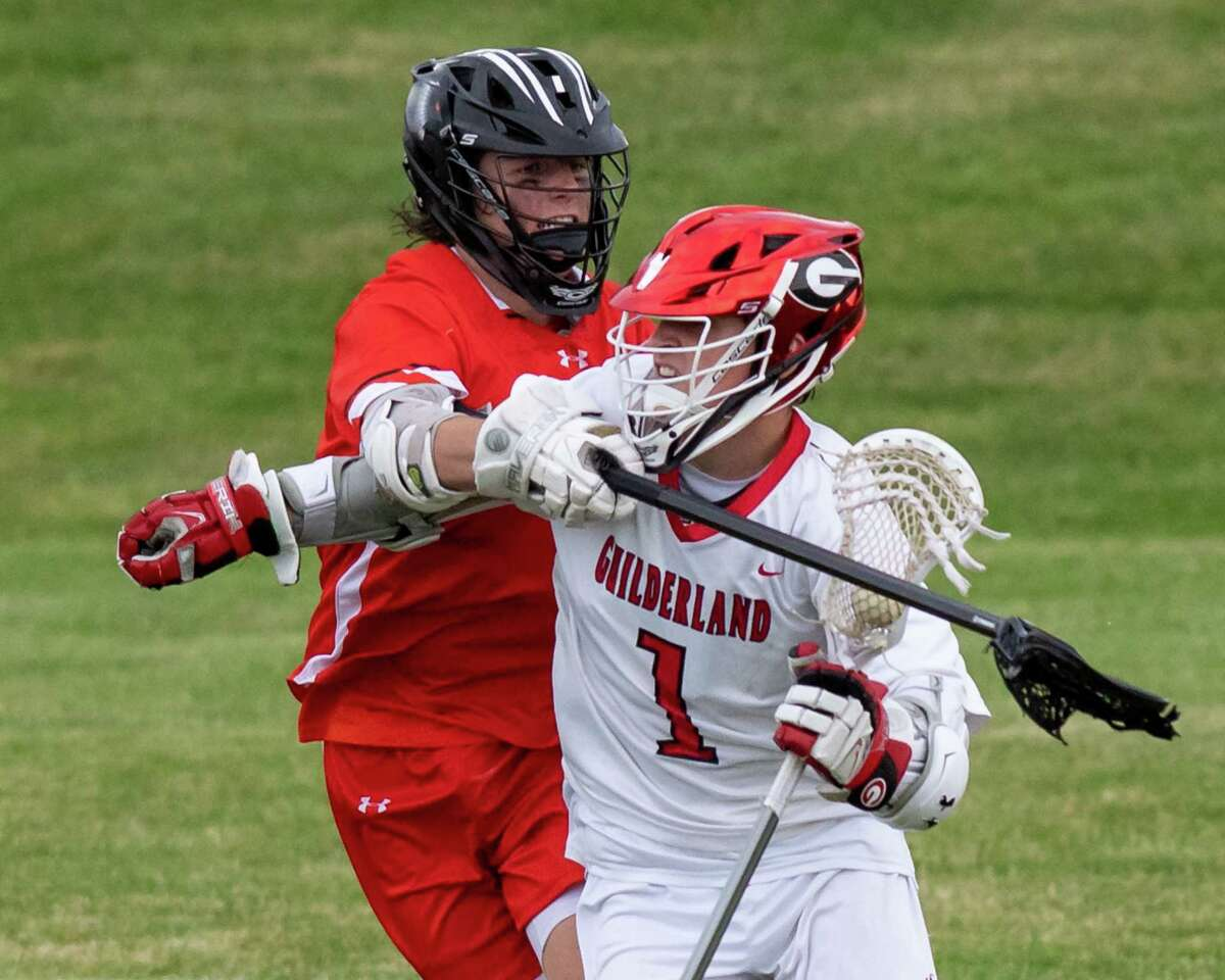 Guilderland attacker Tommy Tyksinski fights off Bethlehem defender Jack Weinert during the Class A semifinals at Guilderland High School on Friday, June 11, 2021. (Jim Franco/Special to the Times Union)