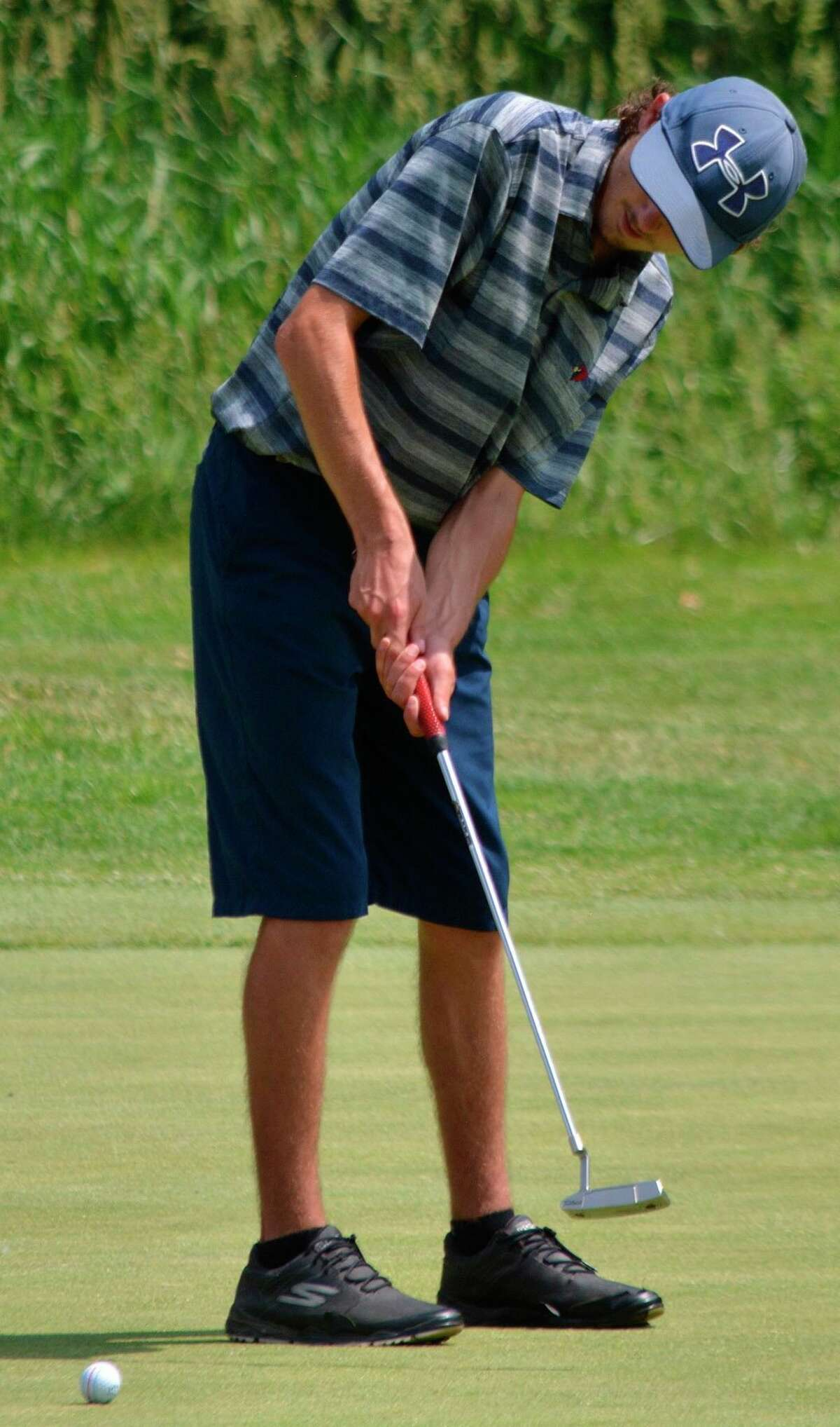 Big Rapids' Brett Lilienthal putts on the Meadows Golf Course on Friday at the Division 3 state finals. (Courtesy photo)