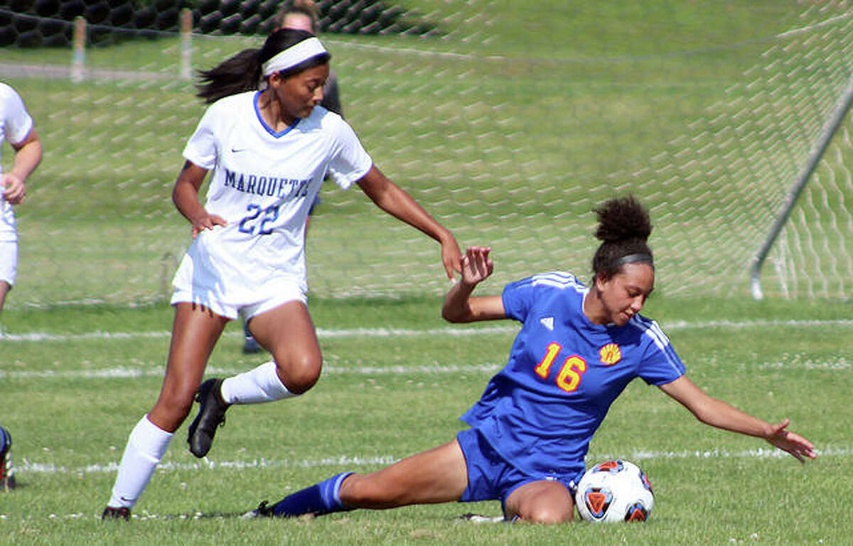 Aela Scruggs of Marquette (22) and Roxana's Jada Covington collide Friday during the Class 1A sectional championship game in Wood River.