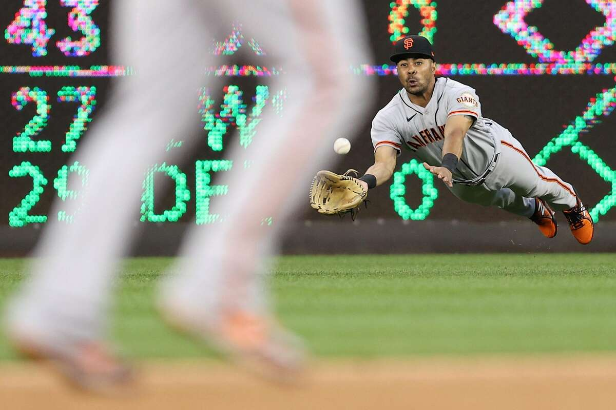 WASHINGTON, DC - JUNE 11: LaMonte Wade Jr #31 of the San Francisco Giants makes a catch against the Washington Nationals during the second inning at Nationals Park on June 11, 2021 in Washington, DC. (Photo by Patrick Smith/Getty Images)
