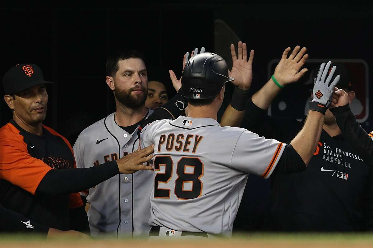 WASHINGTON, DC - JUNE 11: Buster Posey #28 of the San Francisco Giants celebrates his home run against the Washington Nationals during the fourth inning at Nationals Park on June 11, 2021 in Washington, DC. (Photo by Patrick Smith/Getty Images)