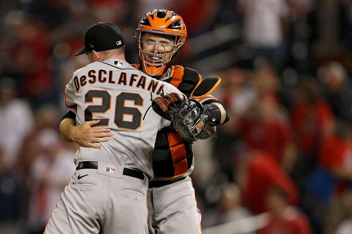 WASHINGTON, DC - JUNE 11: Starting pitcher Anthony DeSclafani #26 of the San Francisco Giants celebrates with catcher Buster Posey #28 after defeating the Washington Nationals at Nationals Park on June 11, 2021 in Washington, DC. (Photo by Patrick Smith/Getty Images)