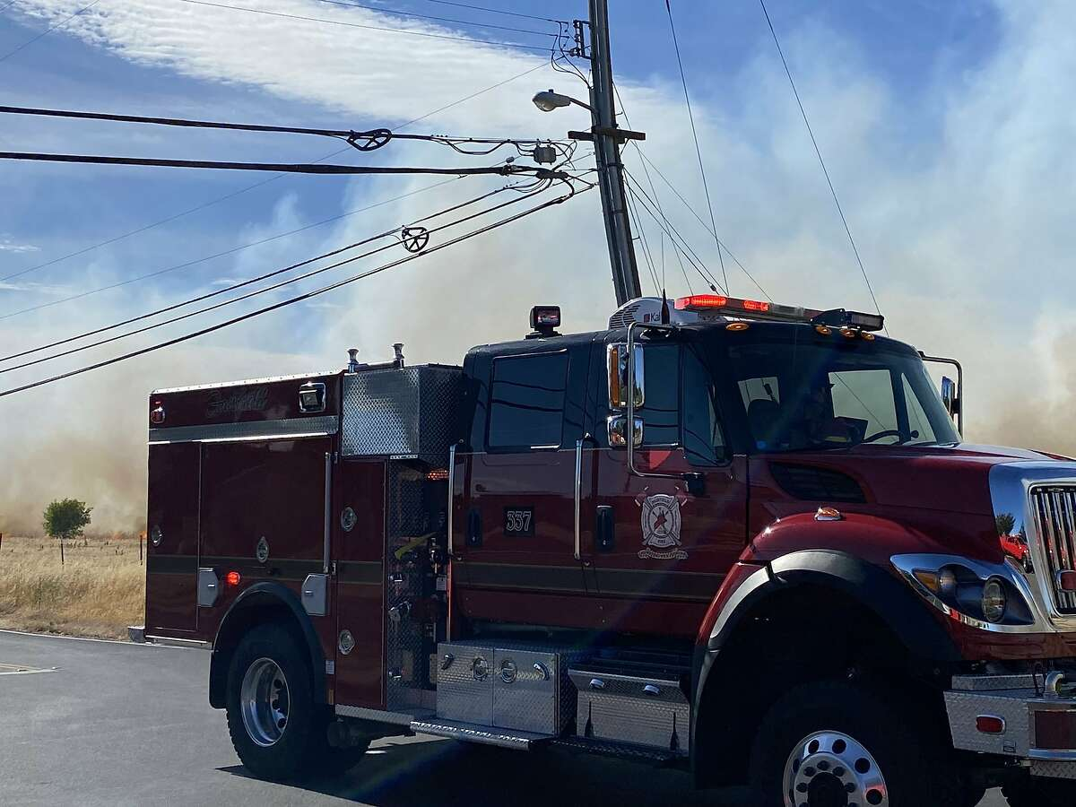 Firefighters were battling a three-alarm grass fire located off Markeley Lane in Fairfield on Friday afternoon, Fairfield Fire Department said.