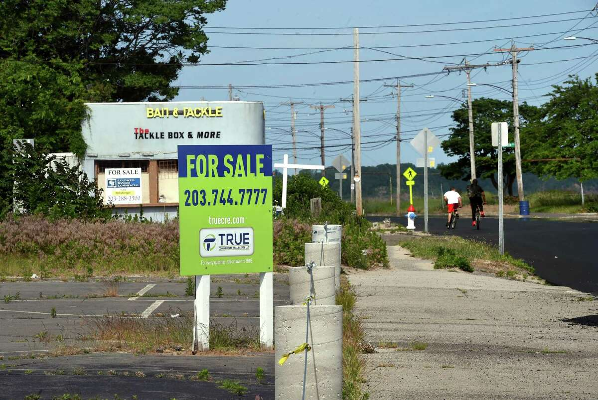 For-sale signs dot Beach Street in West Haven on June 11, 2021.