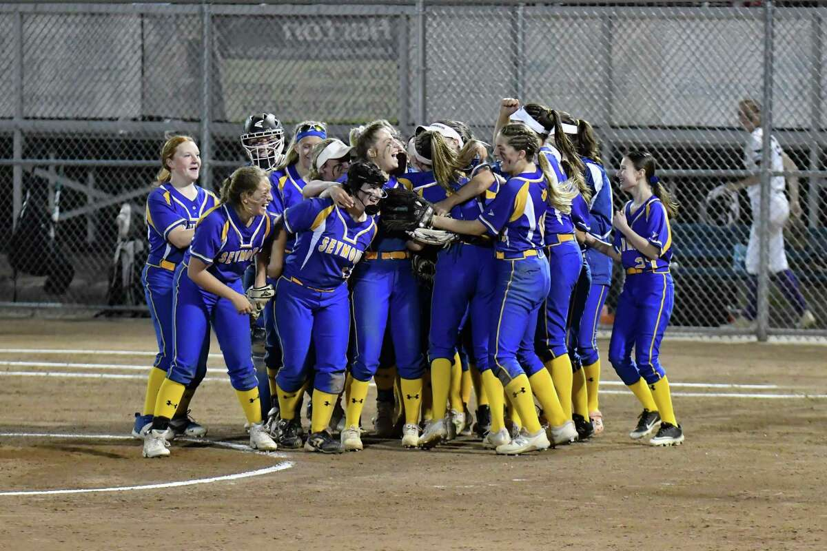 Seymour players celebrate after beating North Branford to win the Class M championship on Friday at DeLuca Field in Stratford.