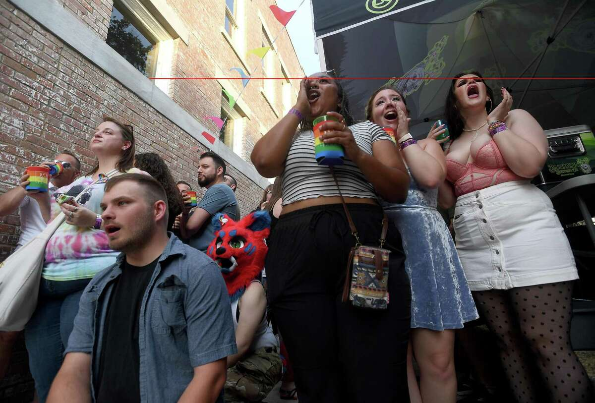 The crowd cheers the drag performances during the Pride Party at 434 Fanin to kick off this weekend's Pride Fest celebrations in Beaumont. Photo made Thursday, June 10, 2021 Kim Brent/The Enterprise