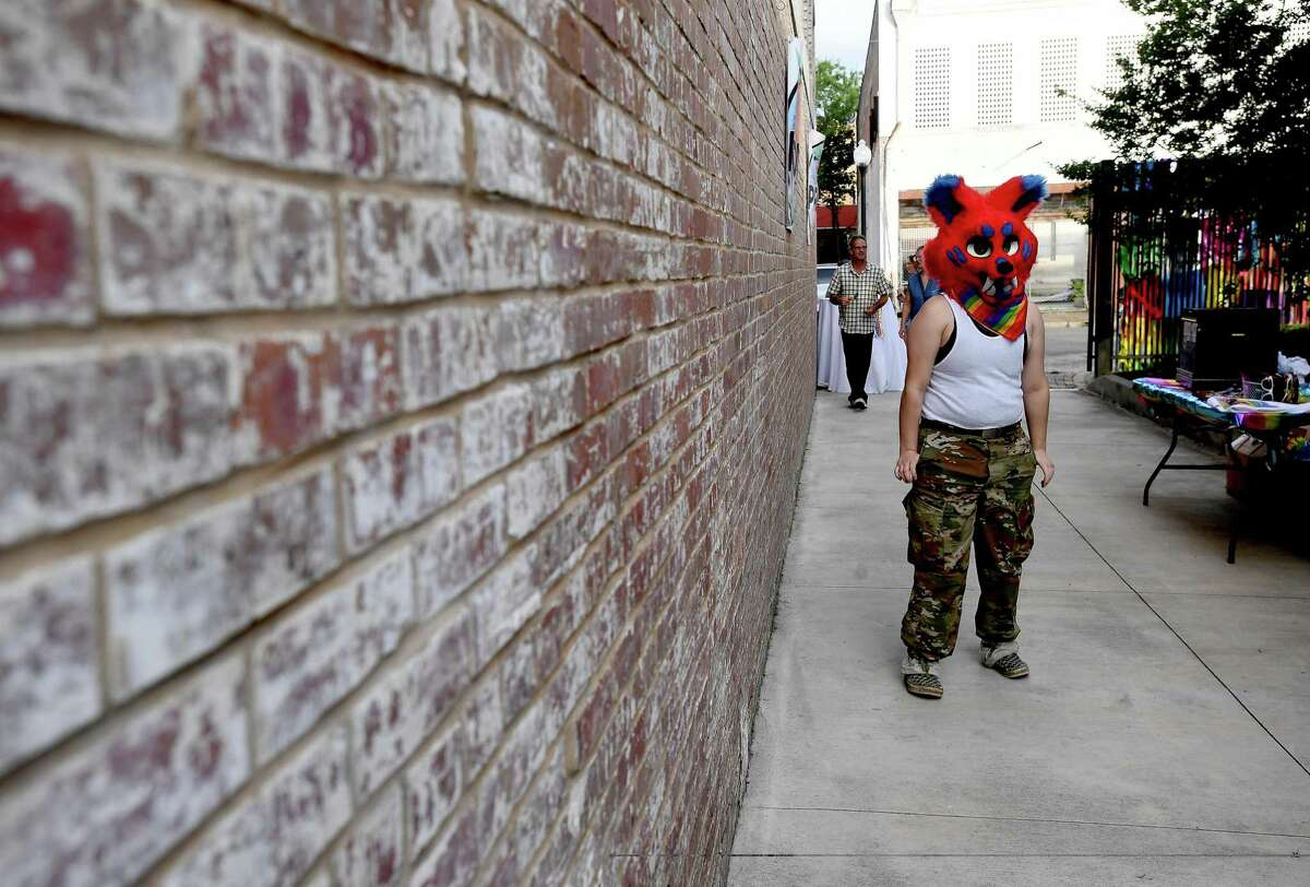 A costumed guest arrives during the Pride Party at 434 Fanin to kick off this weekend's Pride Fest celebrations in Beaumont. Photo made Thursday, June 10, 2021 Kim Brent/The Enterprise