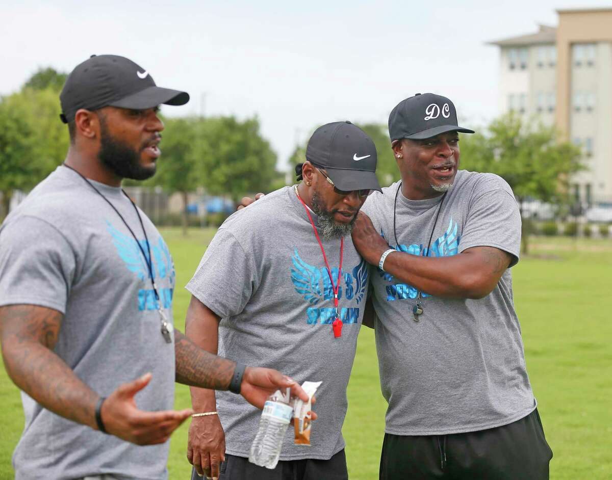 Dominic Cameron, right, jokes with fellow coaches Calvin Anderson, left, and Deese Golg. For the past 10 years, Cameron has hosted DC Speed Camp, a free 16-week program for youth and teens to work on athletic and agility skills at IDEA Harvey E. Najim charter school.