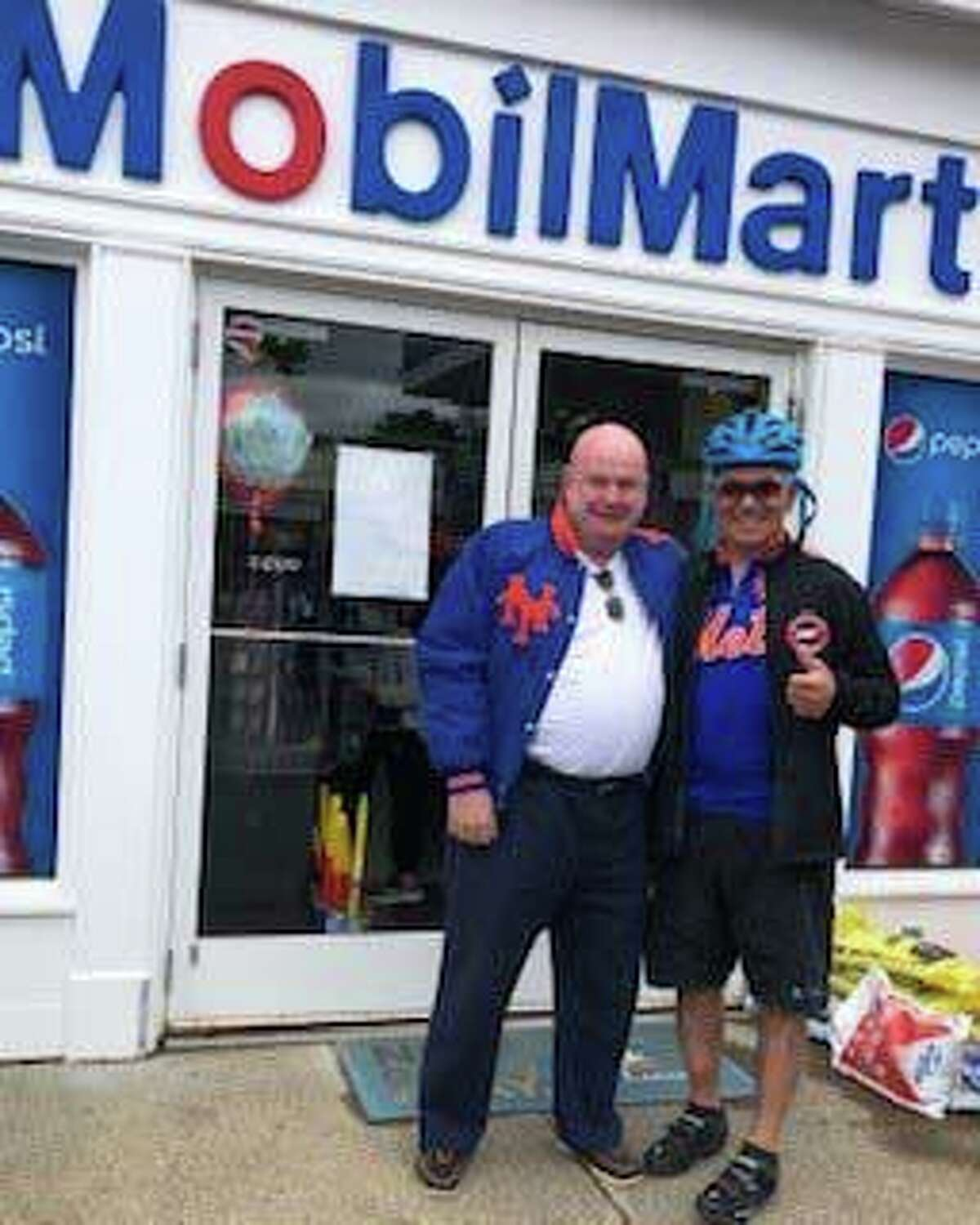 Bobby Valentine was riding his bike through New Canaan and stopped in to see Art Kean, owner of Art's Mobil Mart/Gas on South Avenue, celebrating 46 years in business.