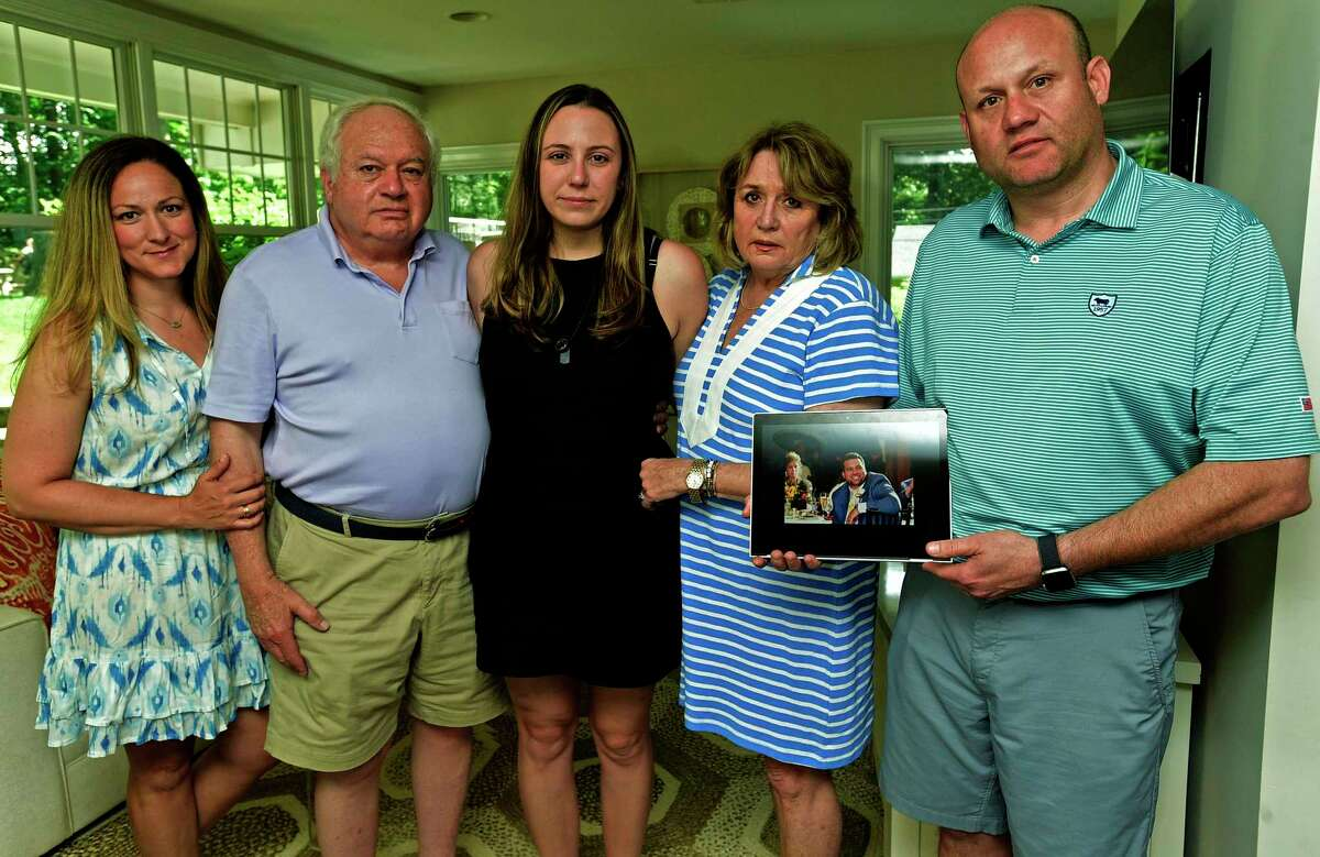 Christopher Andrea's wife, Jamie Andrea, center, sister in law, left, Michelle Andrea, father, Anthony Andrea, mother, Barbara Andrea, and brother, Jeff Andrea, at the home of Jeff and Michelle Andrea Wednesday, June 9, 2021, in Norwalk, Conn. Christopher Andrea of Stamford died unexpectedly on May 28th.