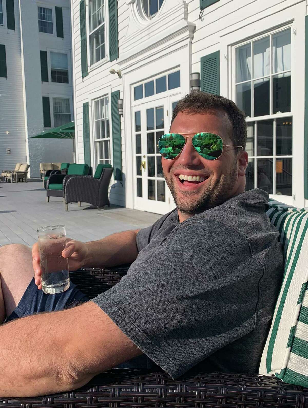 Chris Andrea, of Stamford, poses for a photo in Newport, R.I while celebrating his engagement. He died unexpectedly on May 29, just 10 days after a major leg surgery.