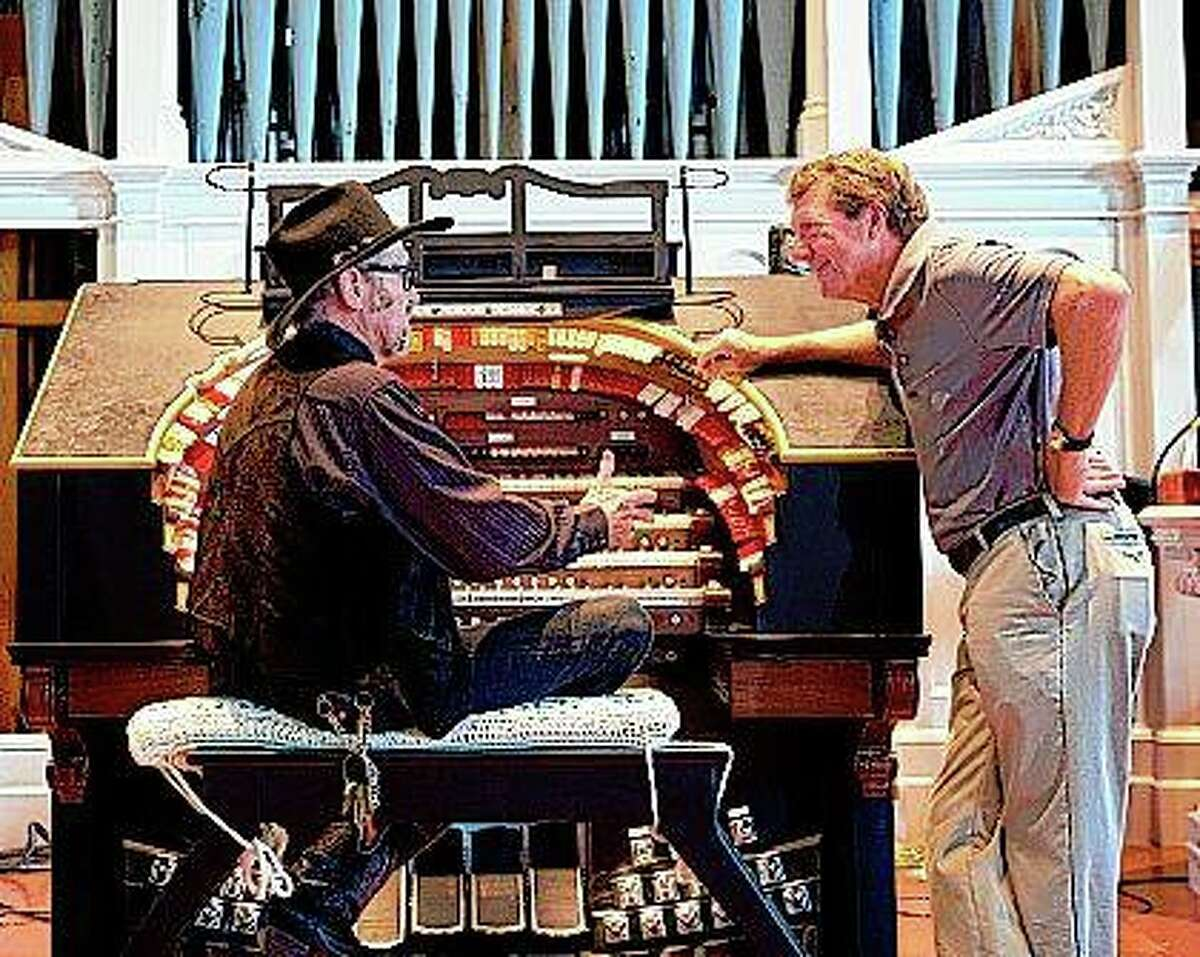 """Scotty DeWolf and Mark McDonald, host of the """"Illinois Stories"""" TV series, talk at DeWolf's Lovejoy Hall in Jacksonville. McDonald will serve as emcee Sunday during DeWolf's """"telethon"""" to raise funds to complete renovations at the Ayers Mansion B&B."""