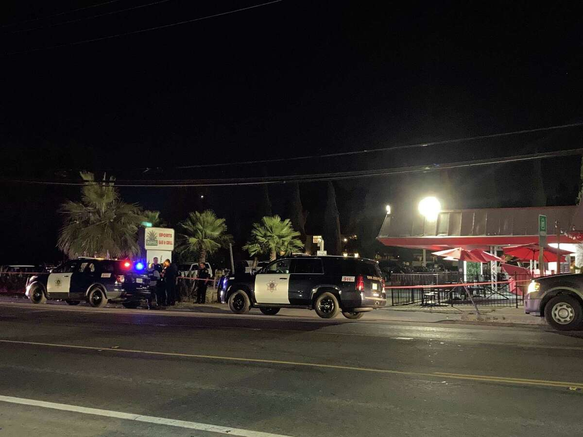 San Jose police investigate the scene of a fatal crash involving a suspected drunken driver at the outdoor dining area of the Agave Sports Bar.