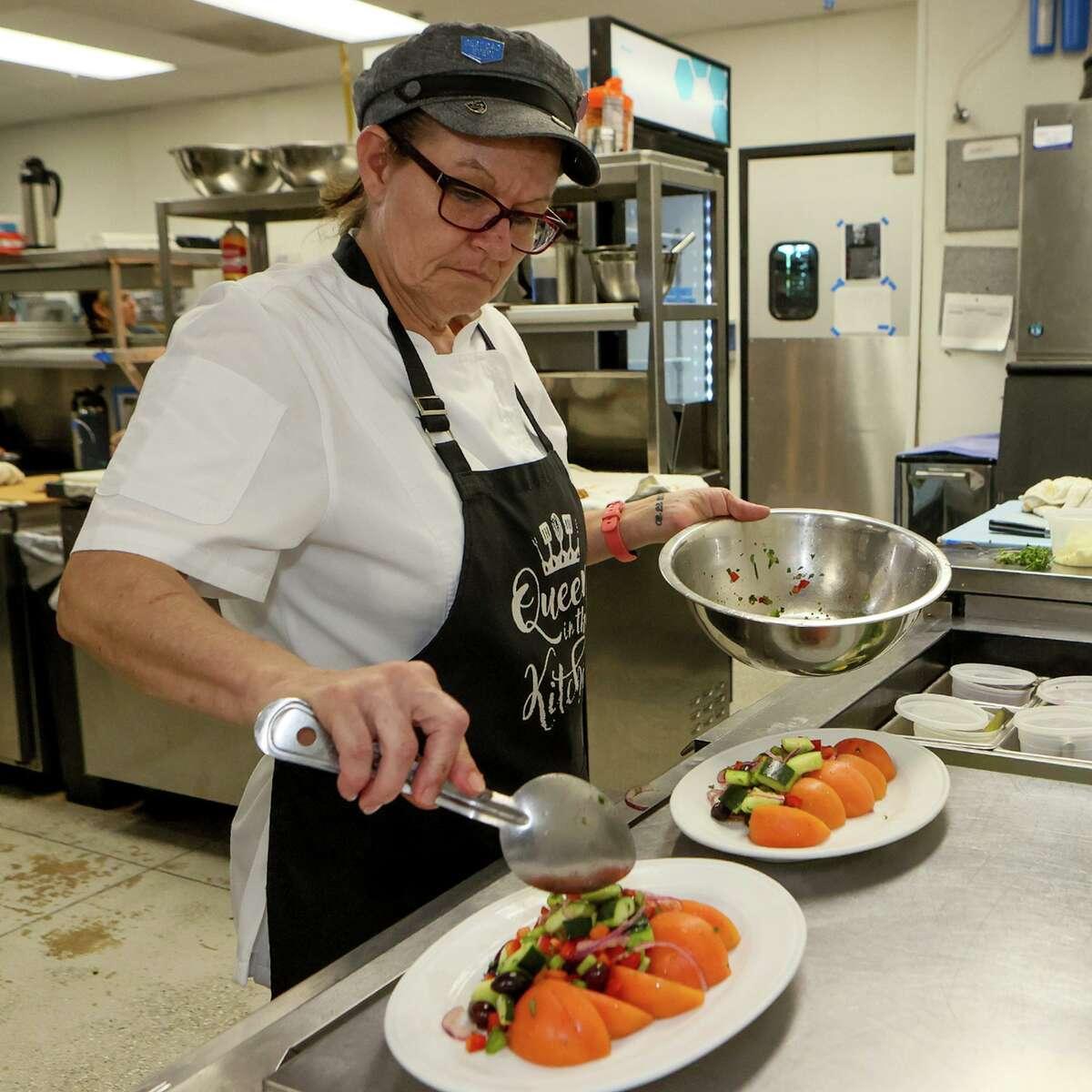 "Melanie Mathews prepares Greek salads at Mako's on the Creek restaurant June 2 in Cibolo. Mako's was named a ""Top 10 Best New Restaurants in San Antonio"" in 2019."