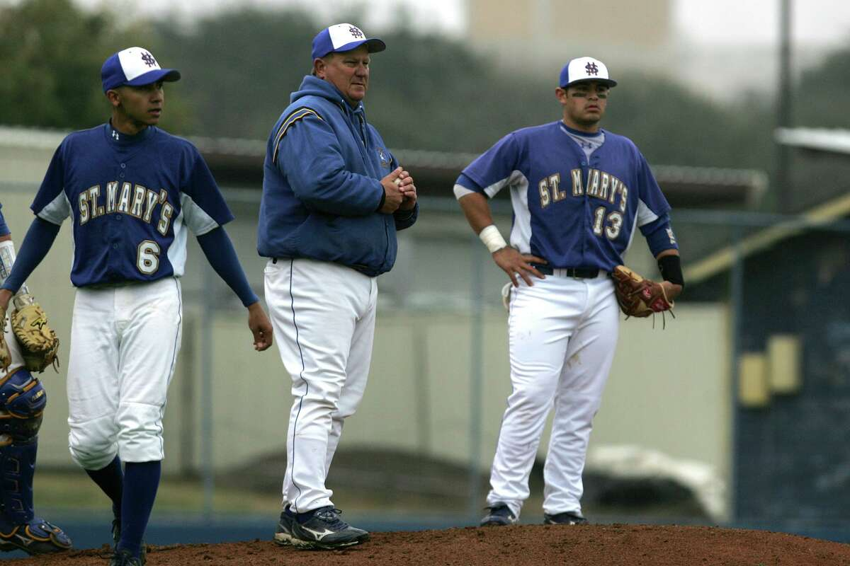 St. Mary's coach Charlie Migl, center, directs his team during a break in play in this 2010 photo. Migl has been at St. Mary's University for more than four decades.